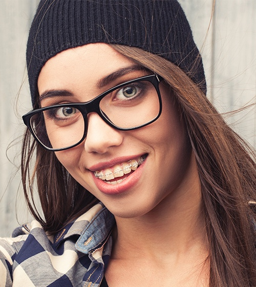 Teen girl with clear and ceramic braces